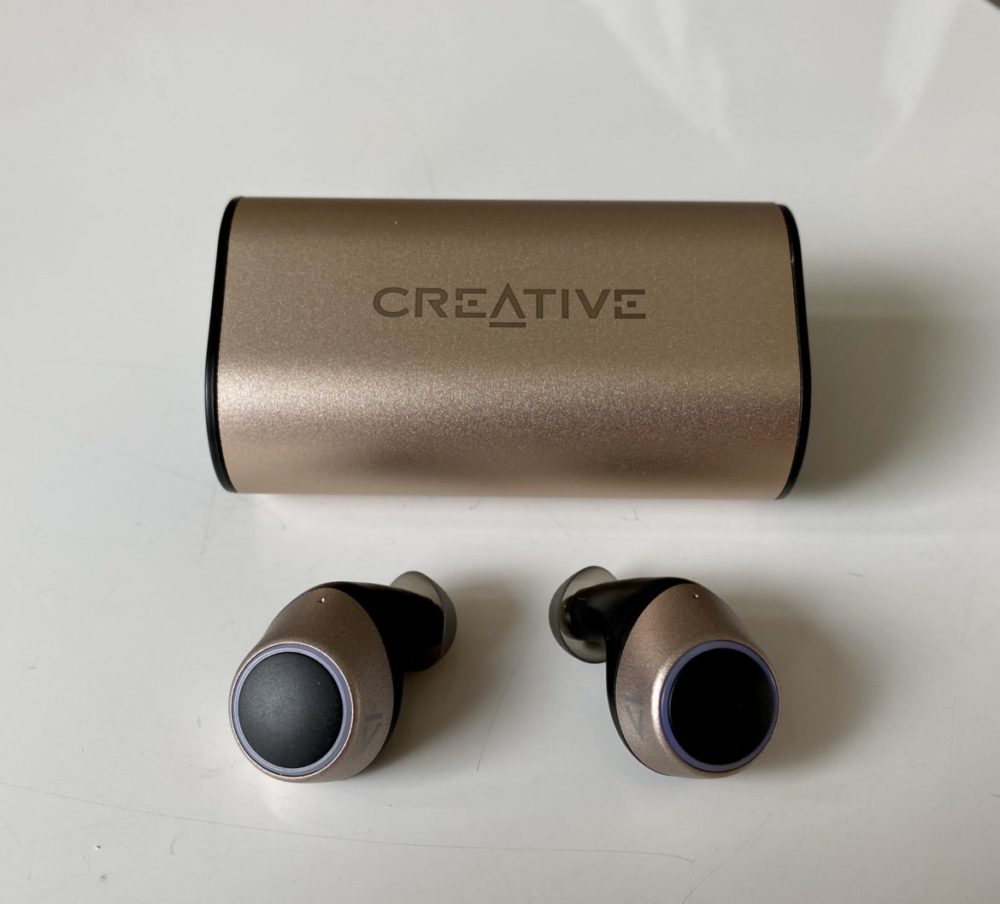 outlier gold headphones and case